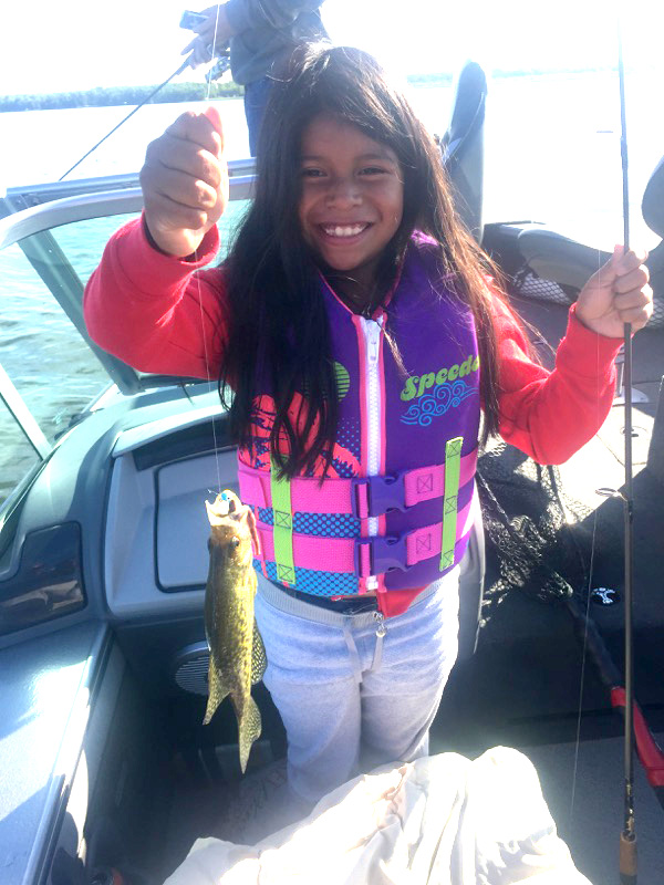 Remington Fishing Guide with young walleye fishergal
