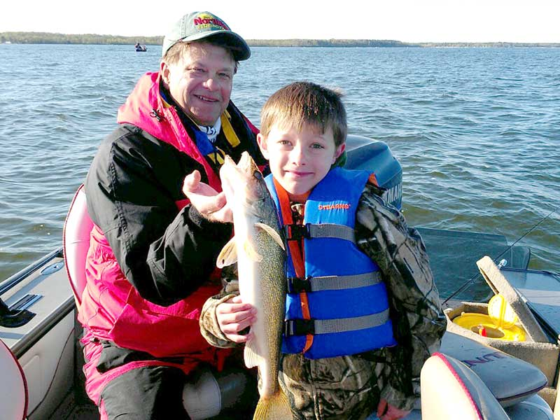 Remington Fishing Guide Randy Erola with young walleye fisherman