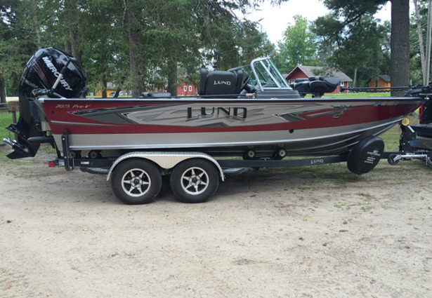 Remington Fishing Guide Service current Lund 1975 Pro-V boat